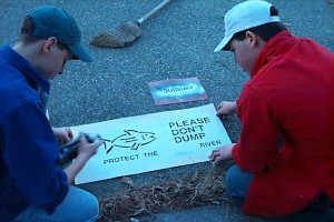 PHOTO - Framingham Scouts Stencil Storm Drains near Sudbury River, Warn People not to Dump Toxic Waste.