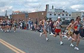 Runners passing through Downtown Framingham in Boston Marathon, 1997
