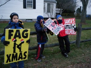 WBC Phelps kids hold up signs.